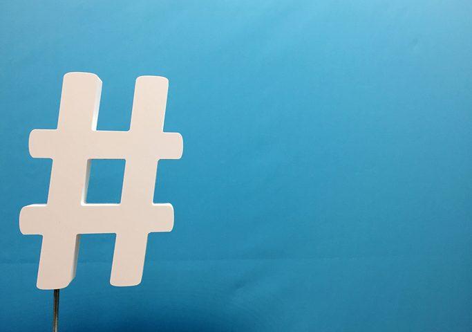 Hashtag Sign Against Blue Background